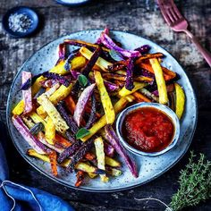 Farm to garden. Smoky oven-roasted Peruvian french fries and salted sweet potatoes served with a lite drizzling of olive oil fresh herbs and a rustic tomato sauce. Enough said. #incredible . Courtesy: @frauherzblut . . . Blog: http://ift.tt/1vCV6pv #manvswild #chef #grill #grilling #bbq #barbecue #parrilla #asado #burger #fries #frenchfries #bacon #lunch #prime #f52grams #feast #instagood #foodstagram #foodgasm #foodpics #foodporn #sexy #photooftheday #feedme #getinmybelly…
