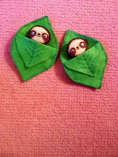 Felt sloths in their little leaf sleeping bag beds :)