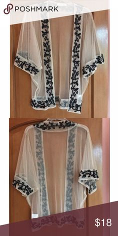 Lace And Black Embroidered Sheer Cover Up This is another great swimsuit Cover Up or perfect light addition to a Stagecoach or Coachella outfit. The lace is a cream color. Only been worn once. Very sheer with beautiful black embroidery. It is similar to Kimono style and fits flowy. Swim Coverups