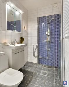 The curved walls of this shower fold inward when you're done bathing, saving precious space in a tiny bathroom. Check out other space-saving tips from this 375-square-foot Swedish apartment on Yahoo! Homes' Spaces blog.