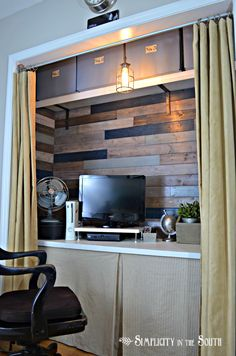 Office In A Closet with great looking features - wood background. Shelf up high and cover the bottom of desk with burlap to hide storage. Curtain covers up clutter.