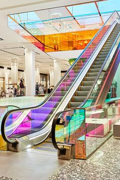 OMA adds iridescent glass escalator to New York's Saks Fifth Avenue. We spotted this new trend to turn ordinary retail interiors in to mesmerizing reflections of color earlier this year. Now Saks has taken on the idea. Mall Design, Retail Design, Store Design, Rem Koolhaas, Shopping Mall Interior, House Restaurant, Chapelle, Atrium, Shopping Center