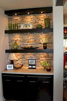**turn nook in basement into trendy basement bar? add mini fridge into cabinetry and you're golden** Typically I don't like the open shelving look in a kitchen, but I really like this with the stone backlay and the under-shelf lighting. Under Shelf Lighting, Task Lighting, Shelves Lighting, Basement Lighting, Livingroom Lighting Ideas, Shelf Lights, Alcove Lighting, Pantry Lighting, Under Counter Lighting