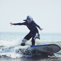 """Take that, France! Muslim girls in burkinis can still catch some waves! #burkiniban  Yesterday, armed French police forced a woman to remove her clothing on Nice Beach following the French burkini ban. For Muslim women, burkinis are a symbol of liberation, not oppression. Everyone should have the freedom to dress as they choose. """"It's not about the burqa. It's about coercion. Coercing a woman out of a burqa is as bad as coercing her into one."""" - Arundhati Roy sent by @muslimtravelers"""