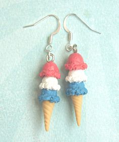 these adorable earrings feature patriotic inspired triple scoop ice cream. these sweet treats are handmade from polymer clay and measures an inch in length. both minis hang from a silver tone hook. th