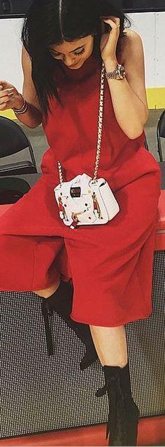 Kylie Jenner: Sunglasses – Dior  Bracelet = Cartier  Purse – Moschino  Shoes – Giuseppe Zanotti X Balmain  Watch – Audemars Piguet