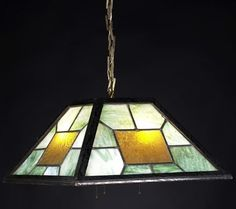SHOP OF THE CRAFTERS hanging light; oak frame, chain and ceiling cap; with leaded slag glass