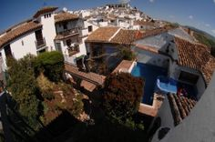 Overview of patios at EnfrenteArte and Ronda city at the back