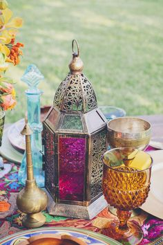 Colourful lanterns would make a pretty candle lit glow #wedding #moroccan #lantern #pink #yellow #glass