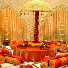 Option for the mehndi night. Love the big long cushions x