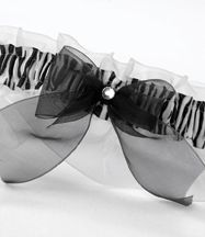 Zebra print grosgrain bachelorette garter with white chiffon ruffles, zebra print pattern, and black chiffon bow with a rhinestone accent.