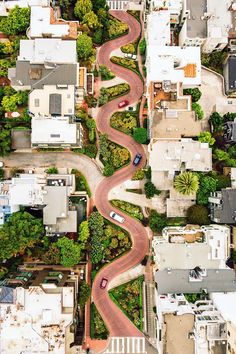 """Lombard Street runs from east to west in San Francisco, California, USA. With eight hairpin turns dispersed over a one-block section in the Russian Hill neighborhood, Lombard is often referred to as """"the most crooked street in the world. Lombard Street, Street Run, Barcelona, San Francisco California, California Usa, Aerial Photography, Terra, Arquitetura, Places"""