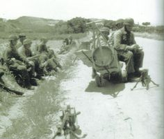 Fallschirmjager of the on a coastal road leading to Canea. Notice the anti-tank rifle in the foreground, the were equipped with anti-tank rifles just in case. Pin by Paolo Marzioli Narvik, Paratrooper, Luftwaffe, Battle Of Crete, Anti Tank Rifle, Military History, World War Two, Troops, Ww2