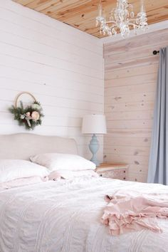 Upholstered bed frame, with white and pink linens   This Mamas Dance