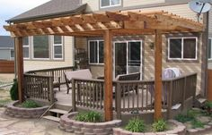 Love the idea of a Pergola over the deck WITH flower boxes for the foundation posts. It will bring MUCH needed shade!