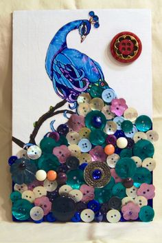 The Crafty Crazy:  Peacock button art, using image of peacock, Mod Podge, hot glue and buttons.  : )