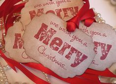 We wish you a Merry Christmas Tags Large Vintage Style - Set of 4  - with Bright Red Ribbon. $4.50, via Etsy.