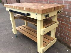 Chunky 5cm solid oak end grain butchers block with 2 slat shelves.  I love this one the colour brightened up our workshop :)  See our Etsy store  https://www.etsy.com/your/shops/me/dashboard?ref=seller-platform-mcnav