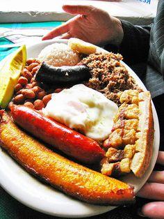 la bandeja paisa: Ground beef, egg, arepa, chorizo, avocado, rice, red beans and chicharron, fried plantains, morcilla. mmm... yummy.