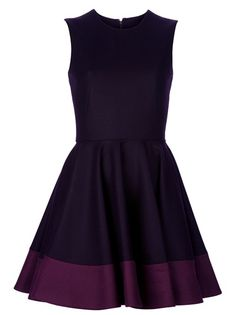 Aubergine felt-wool sleeveless dress from Alexander McQueen featuring round neck, full pleated flared skirt with contrasting burgundy hem and a concealed zip to the back for closure.