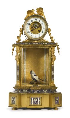 A Napoléon III gilt bronze and champlevé enamel automaton mantel clock France, circa 1870, in the manner of Bontems