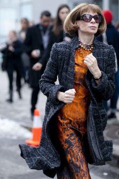Anna Wintour.  Dark tweed long jacekt and orange print sheath.  NYFW Fall 2013