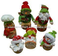 Frascos de vidrio decorados con muñecos navideños