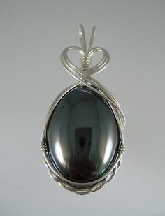 Beautifully done. wire wrapped pendant.  So are the bottom wires mearly loosely twisted?  cool
