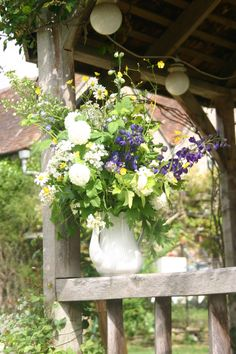 dressing the wedding pergola at gants mill - lovely wedding venue just outside bruton in somerset - flowers in the coffee pot all grown, cut and tied by @theflowerfarmer at www.commonfarmflowers.com