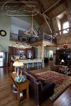 Barn Home   Sand Creek Post & Beam. I like the darker stained cabinets with lighter stained trim