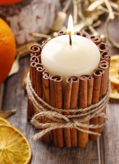 Cinnamon stick candle holder DIY project: Use hot glue to make the cinnamon stick . Cinnamon stick candle holder DIY project: Use hot glue to attach the cinnamon sticks and wrap in gardening yarn. This is one of the ideas for great au. Christmas Candle Decorations, Christmas Candles, Christmas Diy, Xmas, Fall Decorations, Natural Christmas, Diy Candle Holders Christmas, Scandinavian Christmas, Christmas Crafts To Sell Make Money