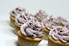Judy in Her Natural Habitat: The Kitchen: Lemon Filled Vanilla Cupcakes with Blueberry Swiss Meringue Buttercream Frosting