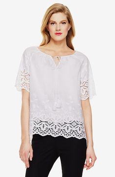 Free shipping and returns on Vince Camuto Eyelet Border Short Sleeve Top (Regular & Petite) at Nordstrom.com. A peasant-style top exudes demure charm in fresh white cotton with a deep border of embroidered eyelet lace around the sleeves and hem. A tassel-tipped drawstring closes up the split neckline