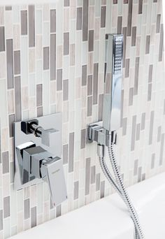 For a different take on the Metro tile trend, use glass mosaics in a metro design. For a different take on the look, install them vertically instead of the traditional horizontal pattern. Design Trends, Glass, Glass Metro Tile, Tiles, Glass Tile, Tile Trends, Ambient Lighting, Metro Tiles, Mosaic Glass