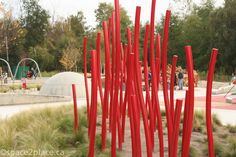 red poles at garden city park playground in Richmond BC. Designed by space2place