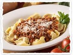 TORTELLONI BOLOGNESE  Olive Garden Recipe   Serves 4   2 tablespoons olive oil  1 onion, finely chopped  1 carrot, finely chopped  1 c...