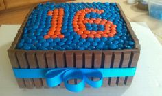 Kit Kat and M cake. Any number can be designed on the top. Square cake easy to wrap with Kit Kat bars. Hint: layout the number first, then fill in background with another color.