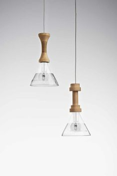 Hanging lamp made from recycled glass + beech wood,Torcia is part of a Chianti Bottle, available in transparent sandblasted glass, or in fumé black glass and wo Design Light, Lamp Design, Lighting Design, Lighting Ideas, Pendant Lamp, Pendant Lighting, Slow Design, Recycled Glass Bottles, Sandblasted Glass