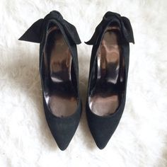 GAP Suede Bow Heels Like new black suede/leather bow heels from GAP. Only been worn once, lightly. Due to the material some areas will look lighter than others but that's just suede for you. Don't miss out on these heels, they're so classic but with a pop of chic. No longer available in store or online.  GAP Shoes Heels