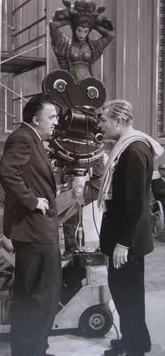 "Federico Fellini and Marcello Mastroianni on the set of ""8½""."