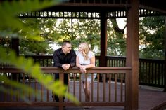 Formal Engagement Session in wooded Gazebo by lake.  White lace dress, black button-down shirt.  ~photo by Awakened Light Photography, Michigan wedding photographer