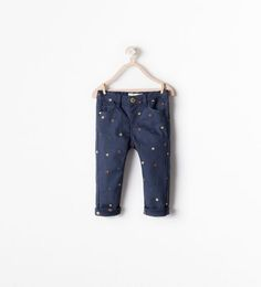 STAR EMBROIDERED SLIM TROUSERS