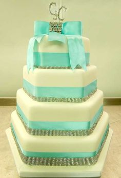 Tiffany Blue Wedding Cake by Genuine Cakes--I like the sparkle on this, the shape of the cake too. I like the color too but not necessarily for your wedding. Just in general.--pst