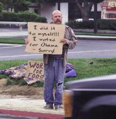 I would seriously give this man money..and food..and a hotel room....he has the most EPIC sign ever