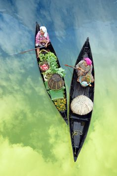earth-song, boats on rainbow water.