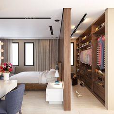Гардеробная, расположенная в спальне и отделенная небольшой стенкой в цвет мебели