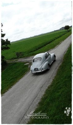 Old car on a country road...beauty.