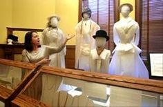"""Museum Educator Sara Buttita said the exhibit """"Fashion Accessories: In Vogue … and Out"""" was fun for the women on staff at the DuPage County Historical Museum to put together."""