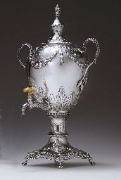 A GEORGE III SILVER TEA URN  LONDON, CIRCA 1772  Urn form, set on four ball-and-claw feet, with a pierced rim, the base with chased garlands, the lower body with applied acanthus, the upper body with chased garlands, with two beaded and leaf-capped handles, and leaf-capped spigot with ivory handle, the double-domed cover with conforming decoration and flame finial, the body engraved on one side with a crest and Viscount's coronet