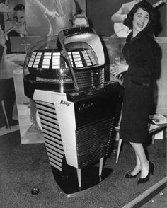 Old photo of woman next to a jukebox